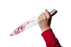 Hand, die ein blutiges Messer hält Lizenzfreie Stockfotos
