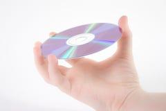 Hand, die ein dvd anhält Stockbild