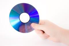 Hand, die ein dvd anhält Lizenzfreies Stockbild