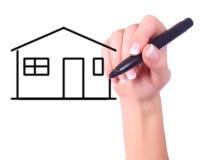 Hand, die ein Haus zeichnet stockfotos