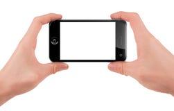 Hand, die ein intelligentes Telefon hält Lizenzfreie Stockfotos