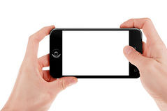 Hand, die ein intelligentes Telefon hält Lizenzfreie Stockbilder