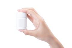 Hand, die ein Tablettenfläschchen hält Lizenzfreies Stockfoto