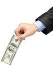 Hand, die eine 100 Dollarbanknote anhält Lizenzfreies Stockfoto