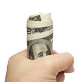 Hand, die eine Handvoll Dollar anhält. Stockfotos