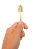 Hand, die eine Taste anhält Lizenzfreie Stockfotografie