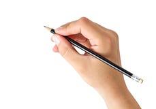 Hand, die einen Bleistift anhält Lizenzfreies Stockfoto