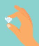 Hand, die einen Diamanten hält Lizenzfreie Stockfotografie
