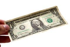 Hand, die einen Dollarschein anhält Stockfotos