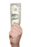 Hand, die einen Dollarschein anhält Stockfotografie