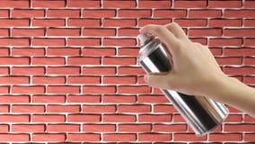 Hand, die einen Graffiti Spray hält Stockbilder