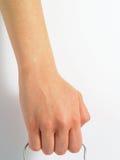 Hand, die einen Griff anhält Lizenzfreies Stockbild