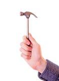 Hand, die einen Hammer anhält Stockfotos