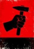 Hand, die einen Hammer hält Lizenzfreies Stockfoto