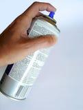 Hand, die einen Spray anhält Lizenzfreies Stockfoto