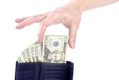 Hand, die einen Zwanzig US-Dollar Bill anhält Stockbild