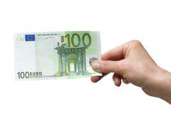 Hand, die Euro 100 anhält Stockfotos