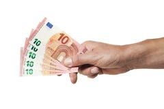 Hand die 50 Euro in 10 Euro rekeningen houdt Stock Afbeeldingen