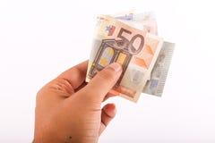 Hand, die Euro hält Lizenzfreie Stockbilder