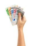 Hand, die Eurogeld hält Stockbild