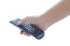 Hand, die Fernsehen Fernsteuerungs hält Stockfotografie