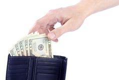 Hand, die für Zwanzig Dollar-Rechnungen erreicht Lizenzfreie Stockfotos