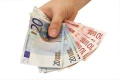 Hand, die Geld gibt Lizenzfreies Stockfoto