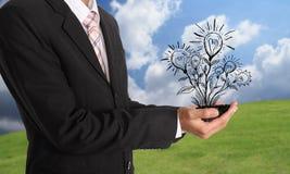 Hand, die Glühlampeillustrationsideenkonzept hält Lizenzfreies Stockfoto