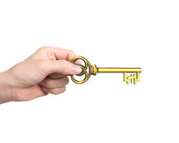 Hand die gouden schatsleutel in de vorm van het pondsymbool houden Stock Afbeeldingen