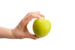 Hand, die grünen Apfel anhält Lizenzfreie Stockfotografie