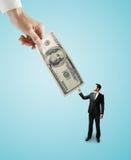 Hand die grote dollars geven Stock Fotografie