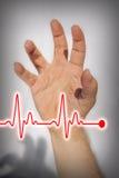 Hand die hartaanval uitdrukken - Medisch concept Stock Afbeeldingen