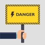 Hand die het gele teken van het eindegevaar houden Vlak stijlontwerp Vector illustratie Stock Foto's