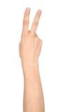 Hand die het teken van overwinning en vredesclose-up tonen Stock Afbeelding