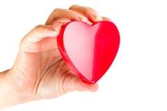 Hand, die Inneres als Liebessymbol anhält Stockbild