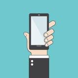 Hand, die intelligentes Telefon anhält Flaches Design Fahrbarer Traktor auf einem weißen Hintergrund Lizenzfreie Stockfotografie