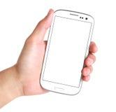 Hand, die intelligentes Telefon auf Weiß hält Lizenzfreie Stockfotografie