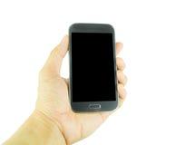 Hand, die intelligentes Telefon auf weißem Hintergrund hält Stockfoto