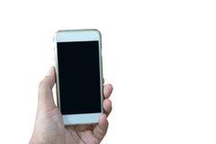 Hand, die intelligentes Telefon lokalisiert über Weiß hält Lizenzfreie Stockfotografie