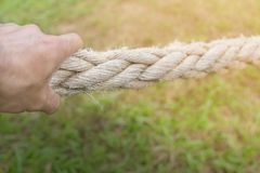 Hand die kabel trekken Stock Foto