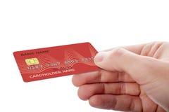 Hand, die Kreditkarte lokalisiert auf wei?em Hintergrund h?lt stockfotografie