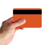 Hand, die Kreditkarte zeigt Stockfotos