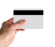 Hand, die Kreditkarte zeigt Stockbilder