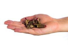 Hand, die Kugeln hält Stockfoto