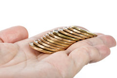 Hand, die Münzen hält Lizenzfreie Stockfotografie