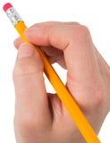 Hand, die mit Bleistiftradiergummi löscht Stockbild