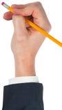 Hand, die mit einem Bleistiftradiergummi löscht Lizenzfreie Stockbilder