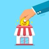 Hand, die Münze in Geschäftsspeicher einsetzt Lizenzfreie Stockfotografie