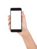 Hand die mobiele slimme telefoon met het lege die scherm houden op wh wordt geïsoleerd Stock Foto
