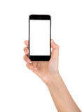 Hand die mobiele slimme telefoon met het lege die scherm houden op wh wordt geïsoleerd